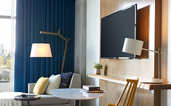 tv and chair guestroom area
